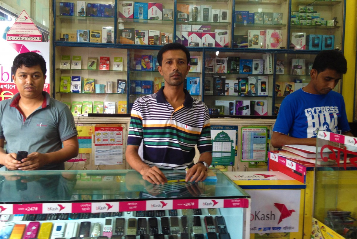 These Dhaka shop-keepers act as agents for bKash, the largest mobile money platform in Bangladesh.